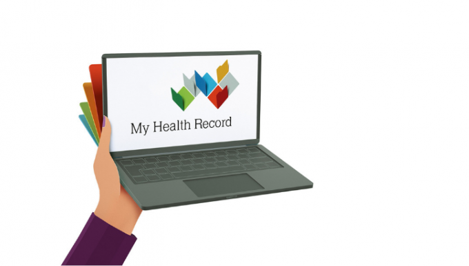 Illustration of a person's hand holding a laptop. The My Health Record logo is displayed on the laptop.
