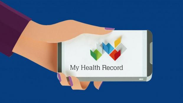 Article image: A female arm holding mobile phone with My Health Record logo